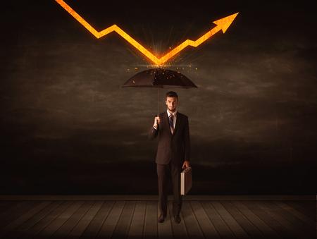 Businessman standing with umbrella keeping orange arrow concept Imagens