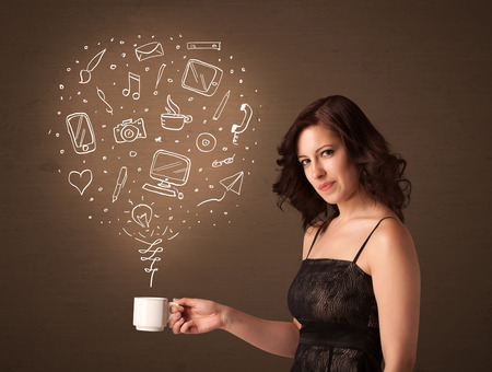 Businesswoman standing and holding a white cup with drown social media icons coming out of the cup Stock Photo