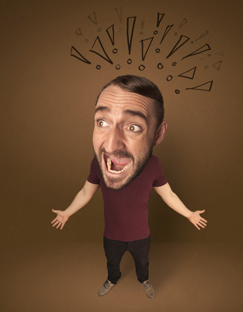 Funny guy with big head and drawn exclamation marks over it Stock Photo