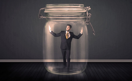 pent: Businessman trapped into a glass jar concept  Stock Photo