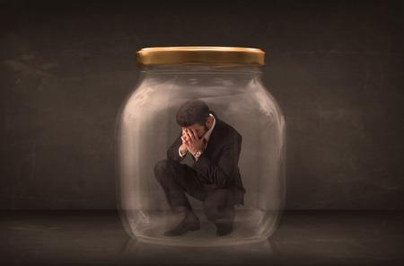 shut: Businessman shut into a glass jar concept