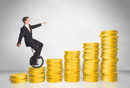 cash cycle: Business man riding mono cycle up on coin graph concept Stock Photo
