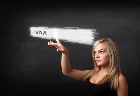 Young woman touching web browser address bar with www sign photo