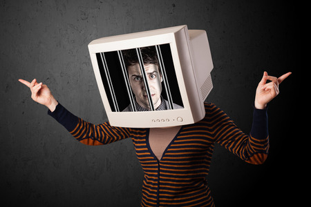 imprisoned: Business man with monitor screen on his head traped into a digital system concept