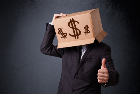 pack of dollars: Young man standing and gesturing with a cardboard box on his head with dollar signs Stock Photo