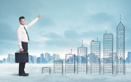 Business man climbing up on hand drawn buildings in city concept photo