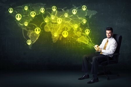 young add: Businessman in office with tablet and social network world map concept on background