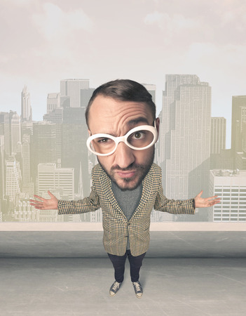 big head: Funny guy with big head, cityscape background Stock Photo