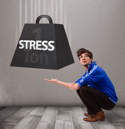 ton: Handsome young boy holding one ton of stress weight