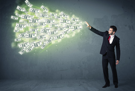 throwing: Business person throwing a lot of dollar bills concept