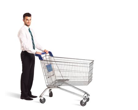 shopping carriage: Businessman pushing a shopping cart on isolated