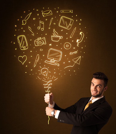 Businessman holding a social media shining balloon on a brown  photo