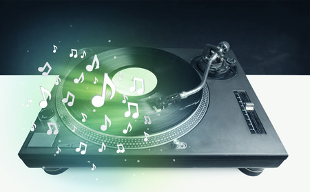 Turntable playing music with audio notes glowing concept  photo