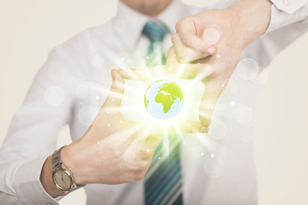 Hands creating a form with shining globe in the center Stock Photo
