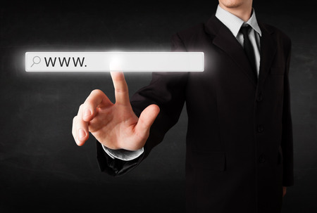 address bar: Young man touching web browser address bar with www sign Stock Photo