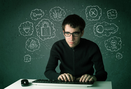 Young nerd hacker with virus and hacking thoughts on green background photo