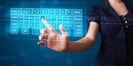 pressing: Young girl pressing virtual type of keyboard Stock Photo