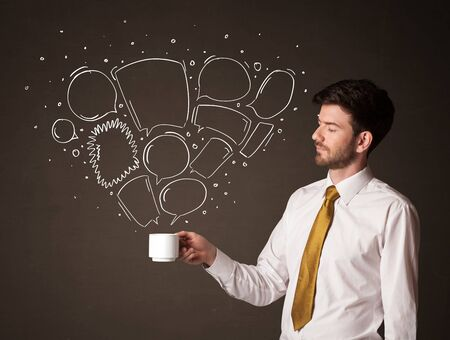 creative force: Businessman standing and holding a white cup with drawn speech bubbles coming out of the cup Stock Photo