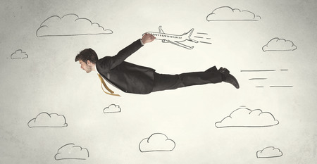 Cheerful business person flying between hand drawn sky clouds concept on background photo
