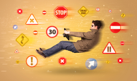 danger ahead: Young driver with road signs around him concept