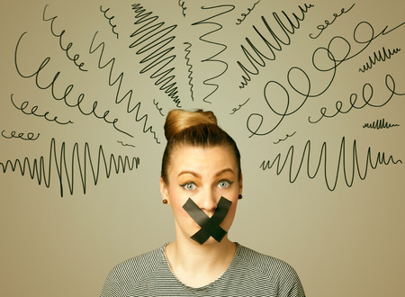 sellotape: Young woman with taped mouth and curly lines around her head Stock Photo