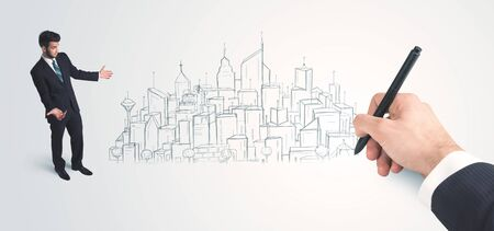 Businessman looking at hand drawn city on wall concept on background photo