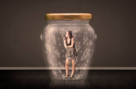 suffocating: Businesswoman inside a glass jar with lightning drawings concept on background Stock Photo