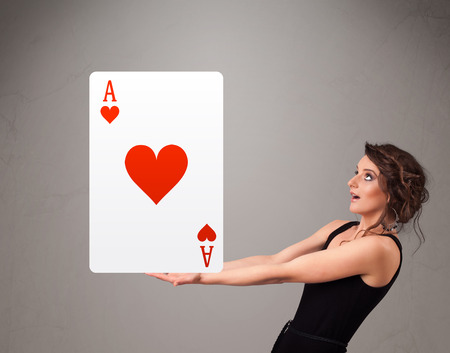 Beautifu young woman holding a red heart ace Stock Photo