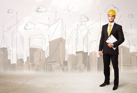 Business engineer planing at construction site with city background concept photo