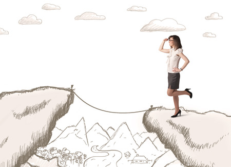bridging the gaps: Businesswoman standing on the hand drawn edge of mountain