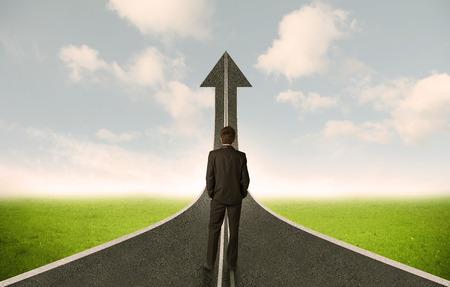 decide deciding: Businessman lokking at 3d road upgoing arrow concept