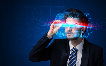 science fiction: Man with future high tech smart glasses concept