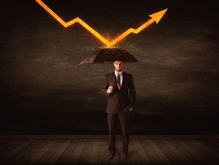 umbrella: Businessman standing with umbrella keeping orange arrow concept on background Stock Photo