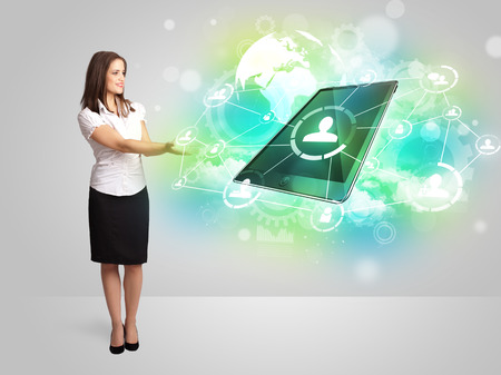 Business girl showing modern green tablet technology concept photo