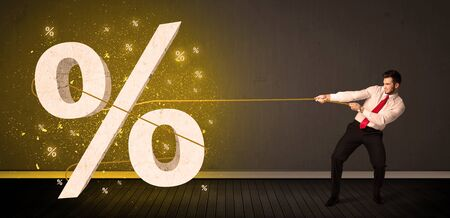 Business man pulling rope with big procent symbol sign concept on background photo