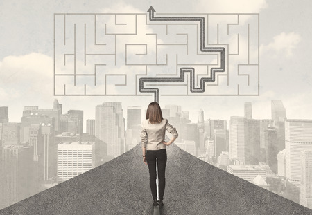 cut through the maze: Business woman looking at road with maze and solution concept Stock Photo