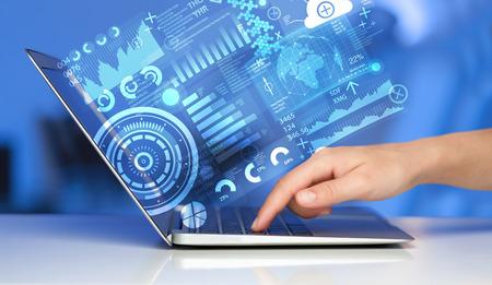 технология: Современный ноутбук с будущим технологий символов СМИ Фото со стока
