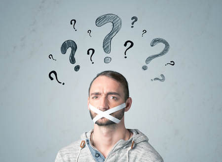 dismay: Young man with taped mouth and question mark symbols around his head