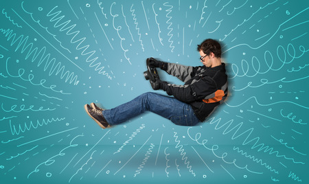 Funny guy drives an imaginary vehicle with drawn lines around him concept Stock Photo