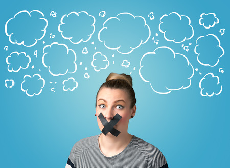 dismay: Funny person with taped mouth and hand drawn clouds around head Stock Photo