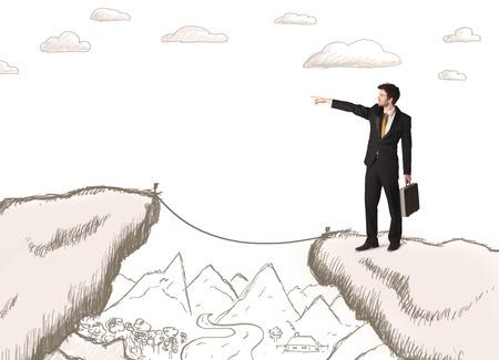 bridging: Businessman standing on the hand drawn edge of mountain Stock Photo