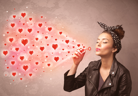 lips kiss: Pretty young girl blowing valentine red heart symbols