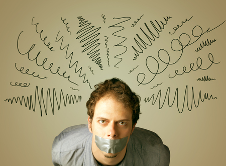 dismay: Young man with taped mouth and curly lines around his head Stock Photo