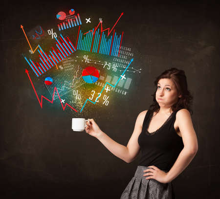 winning stock: Businesswoman standing and holding a white cup with diagrams and graphs coming out of the cup