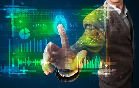 フィンガー プリント リーダーと近代的な技術のパネルを押すとビジネスマン