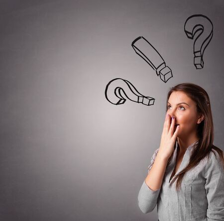 proble: Beautiful young lady thinking with question marks overhead Stock Photo
