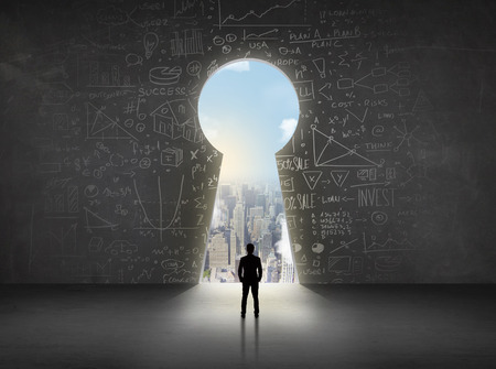 opportunity concept: Business man looking at keyhole with bright cityscape concept background