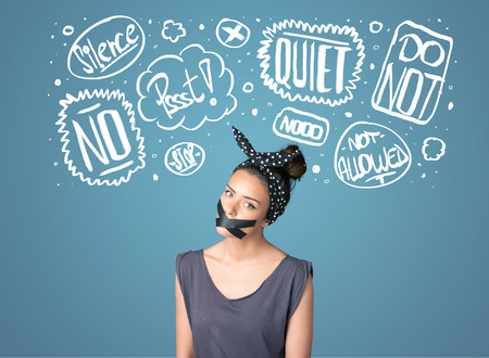thought clouds: Young woman with taped mouth and white drawn thought clouds around her head