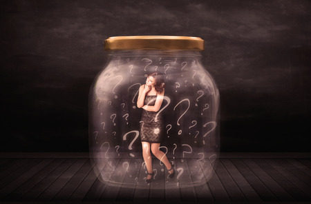 claustrophobia: Businesswoman locked into a jar with question marks concept on background Stock Photo