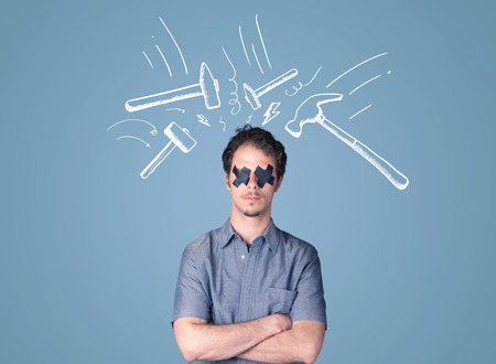 sellotape: Young man with taped eye and white drawn beating hammer marks around his head